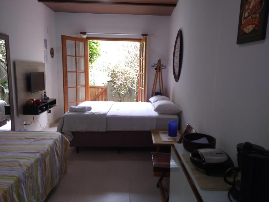 A bed or beds in a room at Loft da Montanha (A 8min do centro)