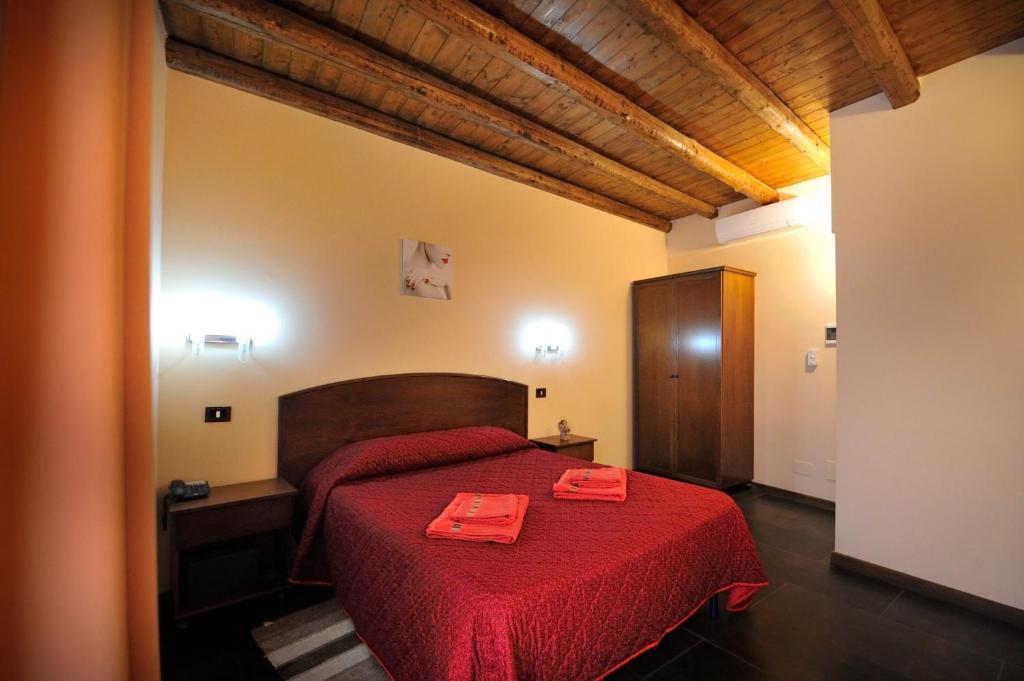 Letto o letti in una camera di Hotel Piccolo