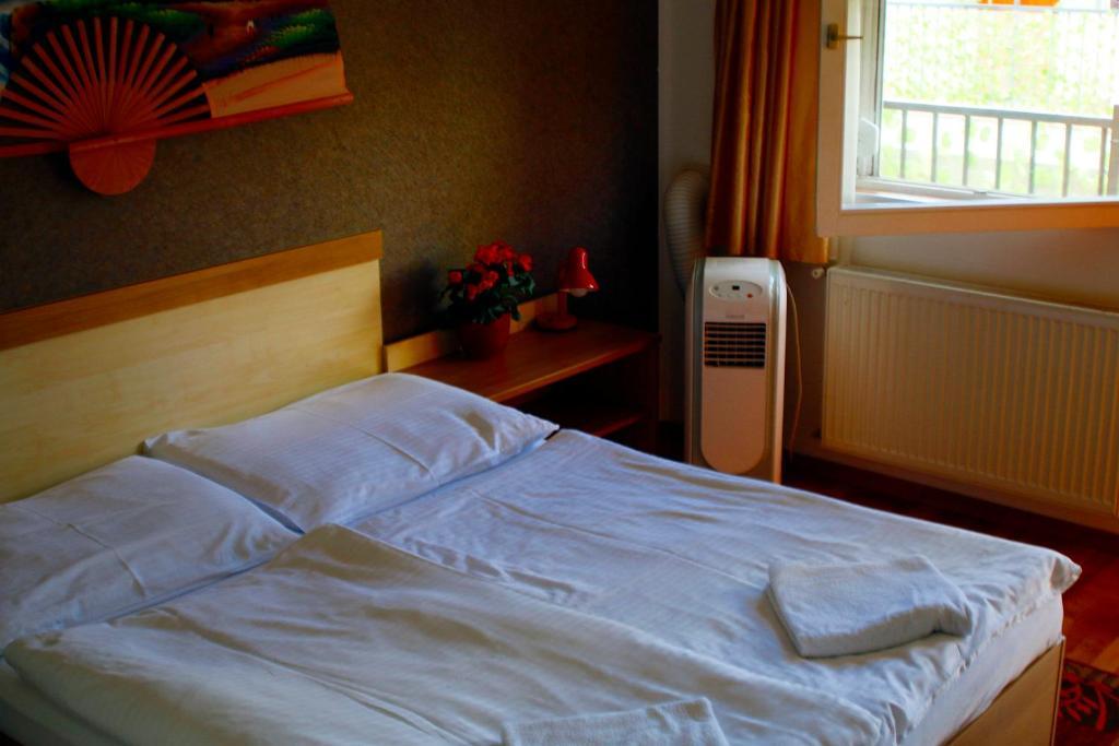 Posteľ alebo postele v izbe v ubytovaní Silver Hotel Budapest City Center