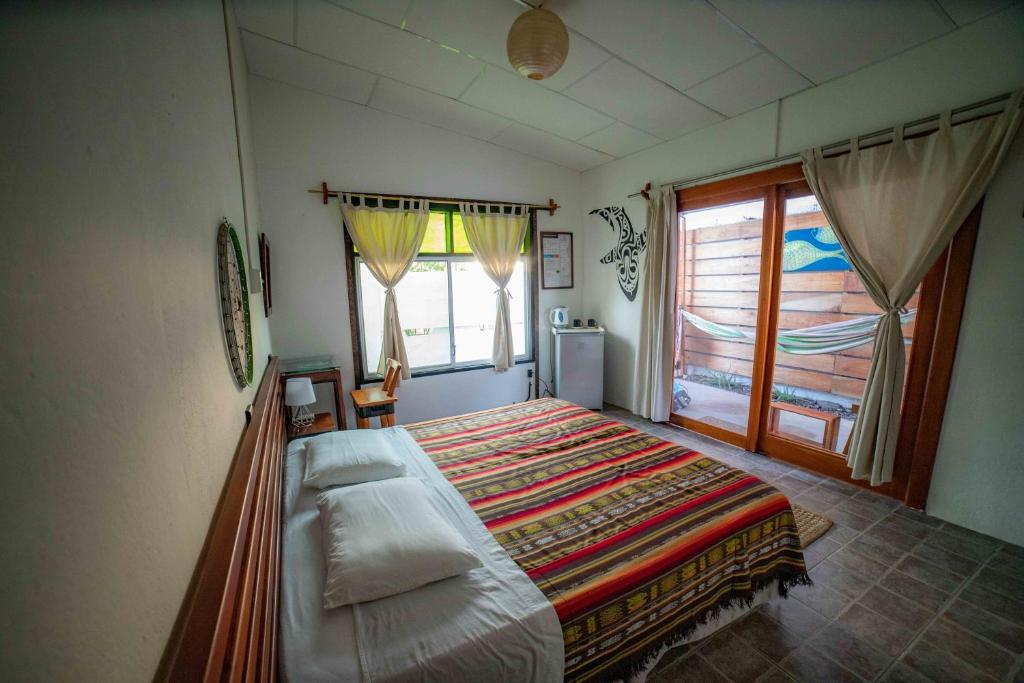 A bed or beds in a room at La K-leta Boutique Guesthouse