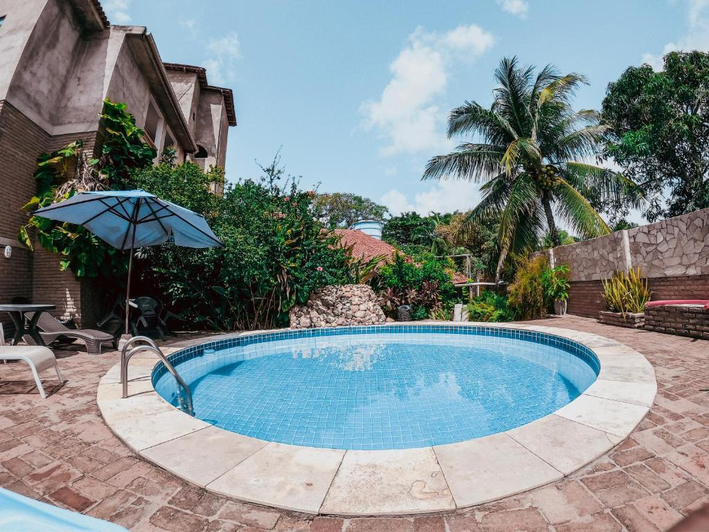 The swimming pool at or close to Lua Pousada