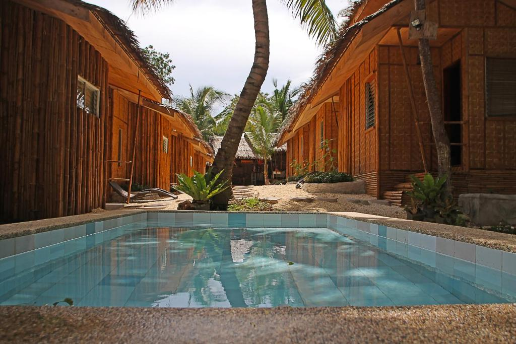 The swimming pool at or close to Ecostay Panglao Resort Hotel