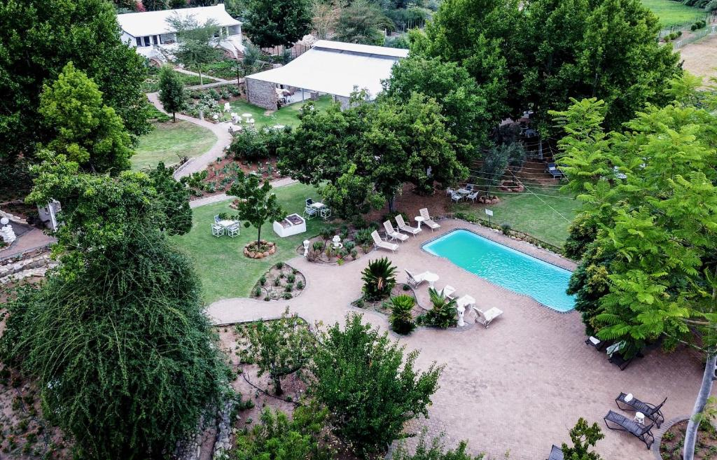 A view of the pool at De Opstal Country Lodge or nearby