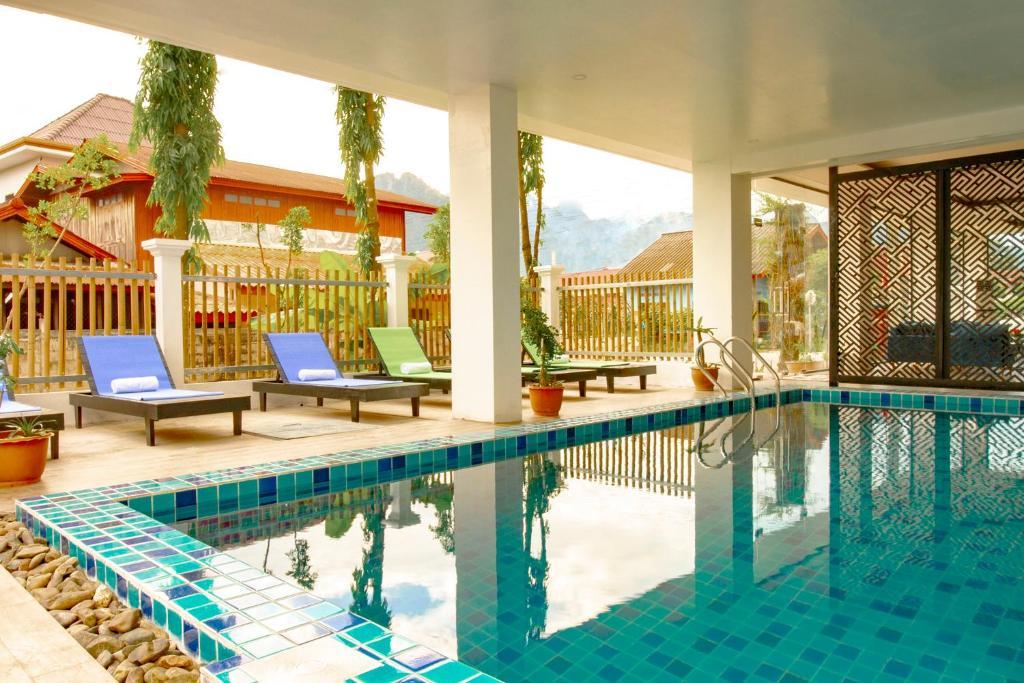 The swimming pool at or near Serene Premier VangVieng Hotel