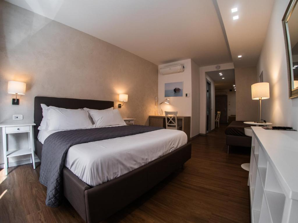 A bed or beds in a room at Prestige Rooms Chiaia