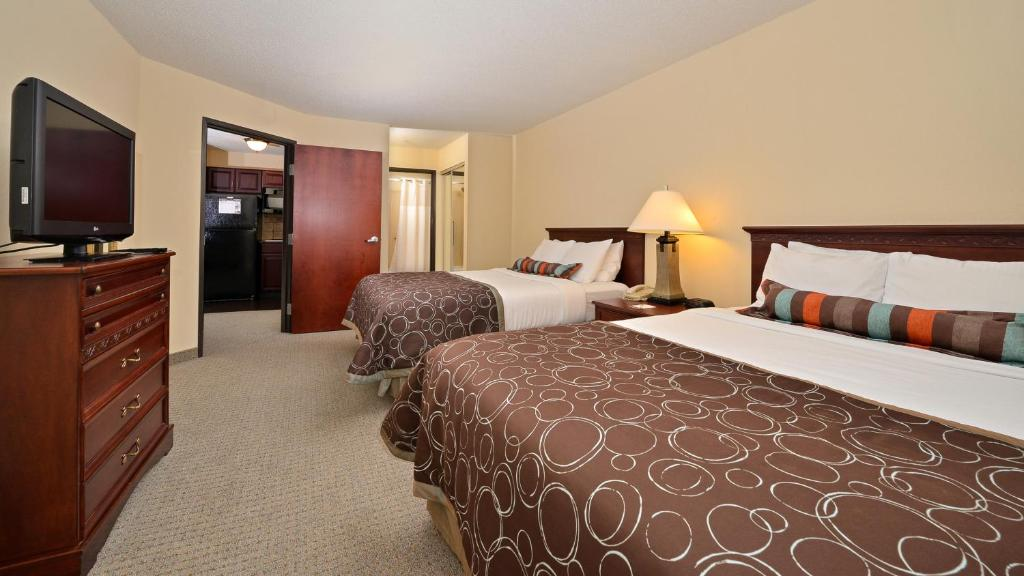 A bed or beds in a room at Staybridge Suites West Des Moines
