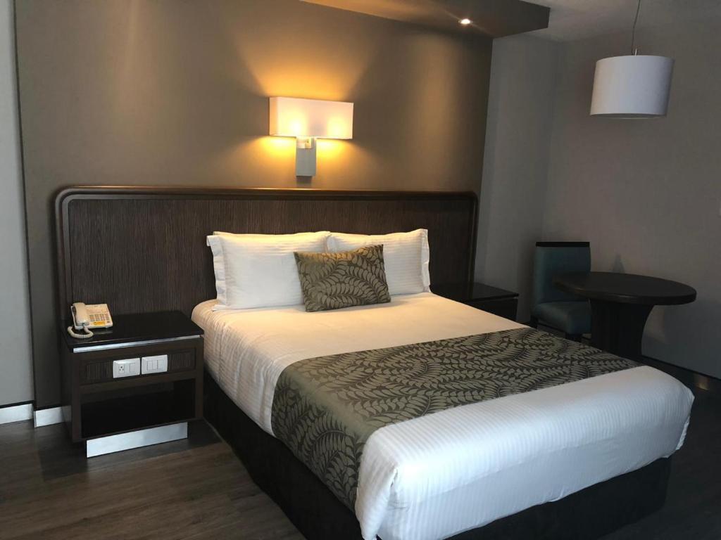 Cama o camas de una habitación en Hotel Metropol