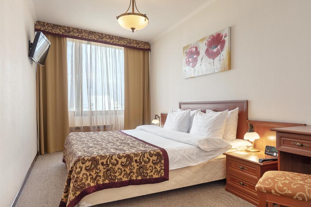 Кровать или кровати в номере Отель Аструс Москва