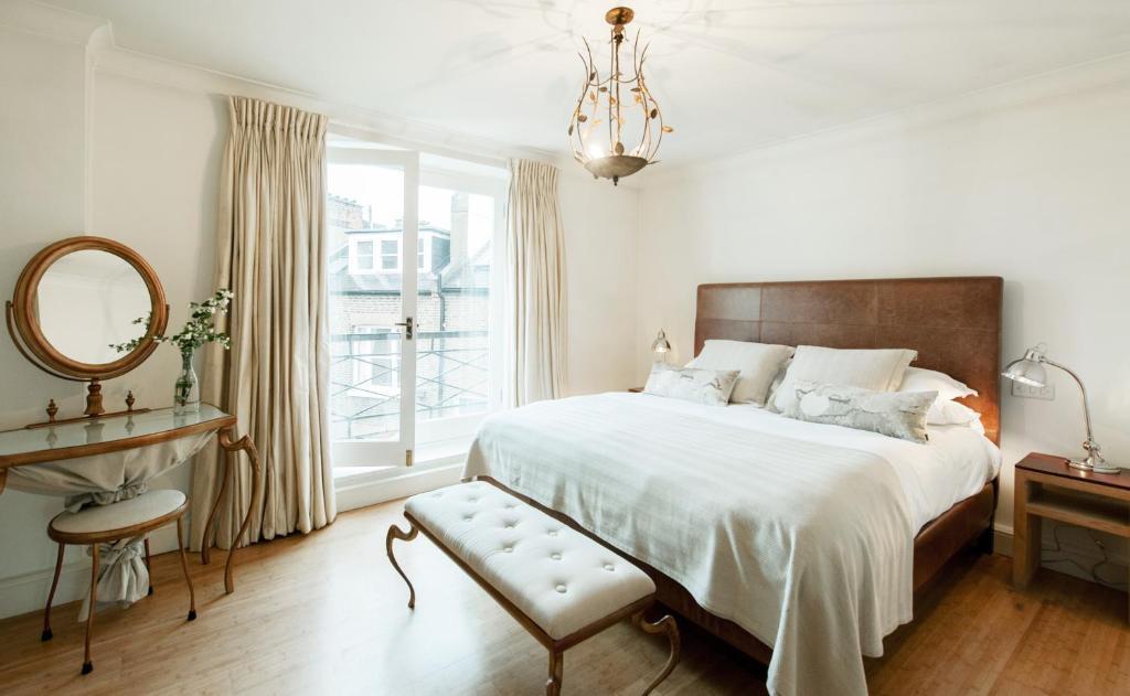 Säng eller sängar i ett rum på Europa House Apartments