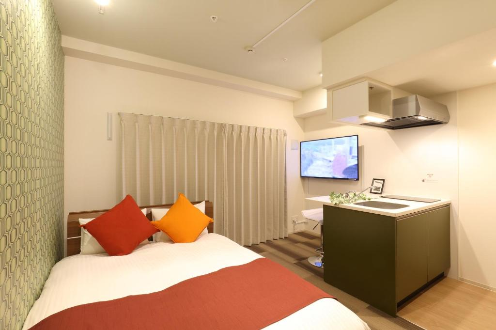 A bed or beds in a room at Residence Hotel Hakata 19