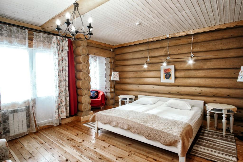 Кровать или кровати в номере Гостиница Малые Карелы