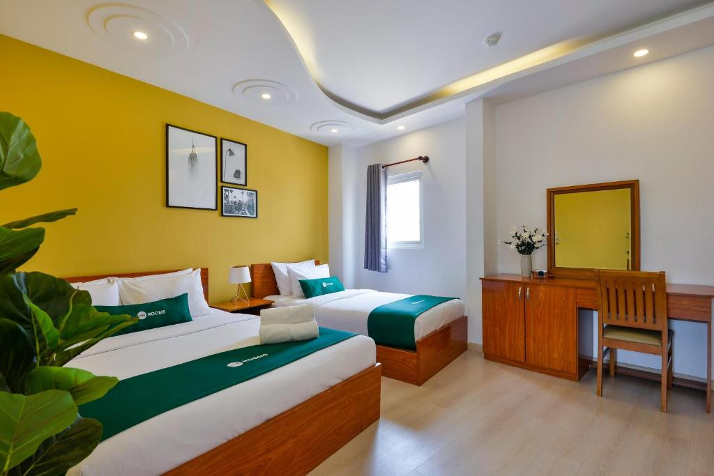 Cama o camas de una habitación en AHA Bliss Boutique Saigon Hotel