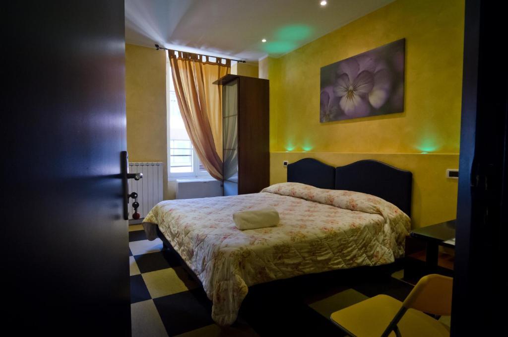 Letto o letti in una camera di Pollon Inn Sanremo