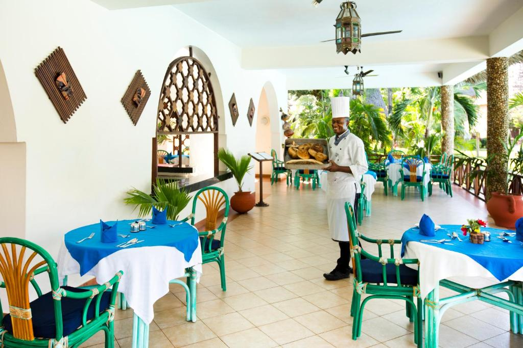 A restaurant or other place to eat at Neptune Paradise Beach Resort & Spa - All Inclusive