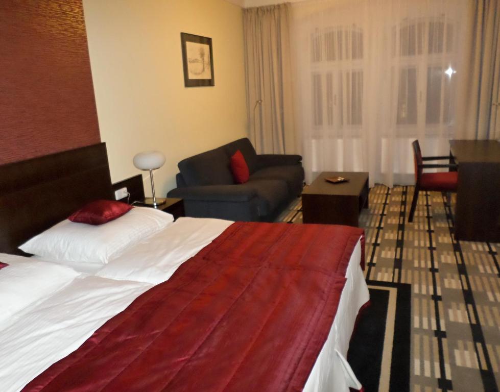 מיטה או מיטות בחדר ב-Karlova 25 Apartments