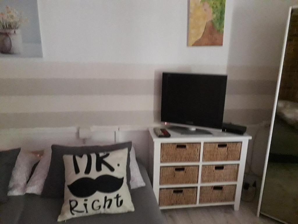 A television and/or entertainment center at After Eight Apartment