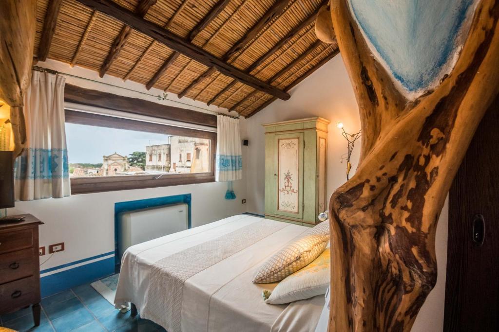 Letto o letti in una camera di Hotel Anticos Palathos