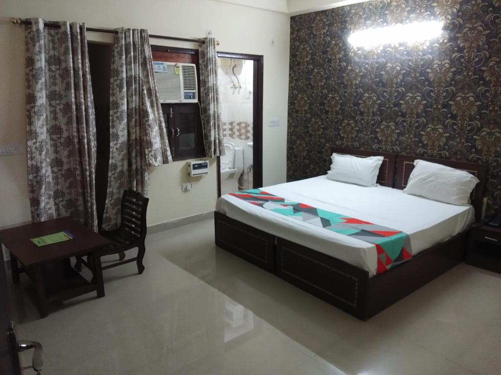 A bed or beds in a room at HOTEL FAIR MOUNT