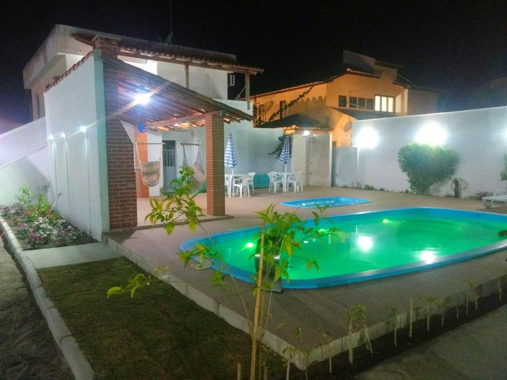 The swimming pool at or near Residencial Mar Da Galileia