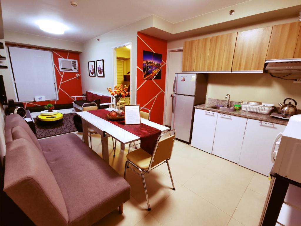 A kitchen or kitchenette at Avida Tower's Condominium Near Naia Airport