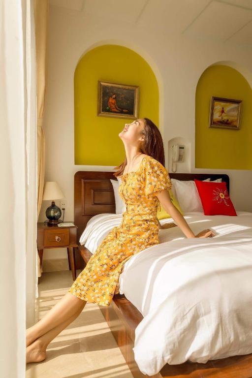 Phòng Deluxe 2 Giường Đơn Có Ban Công Và Dịch Vụ Giặt Là