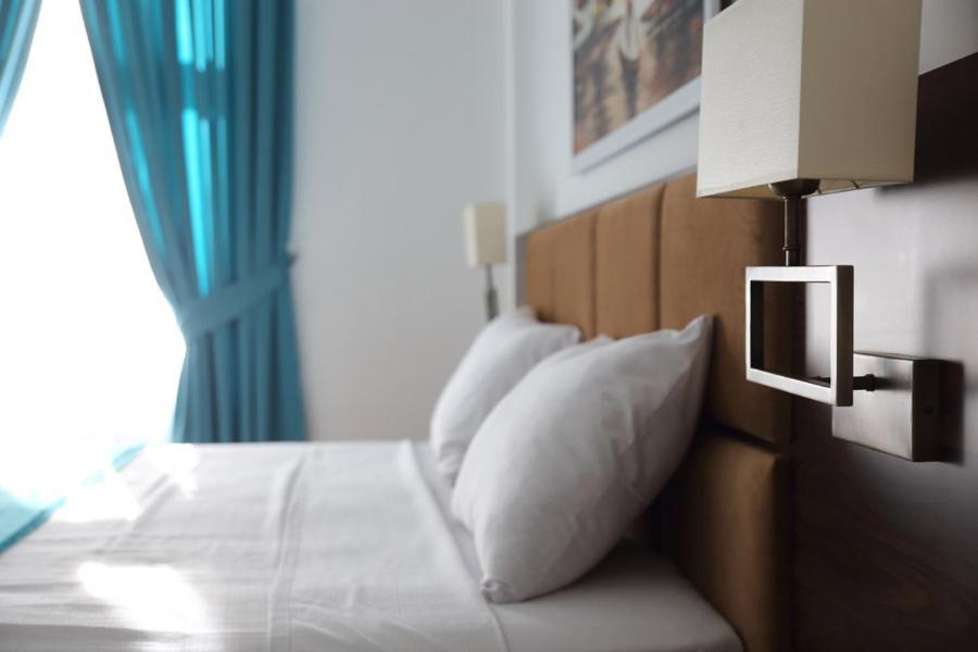 Ein Bett oder Betten in einem Zimmer der Unterkunft A&F Hotel Chemnitz