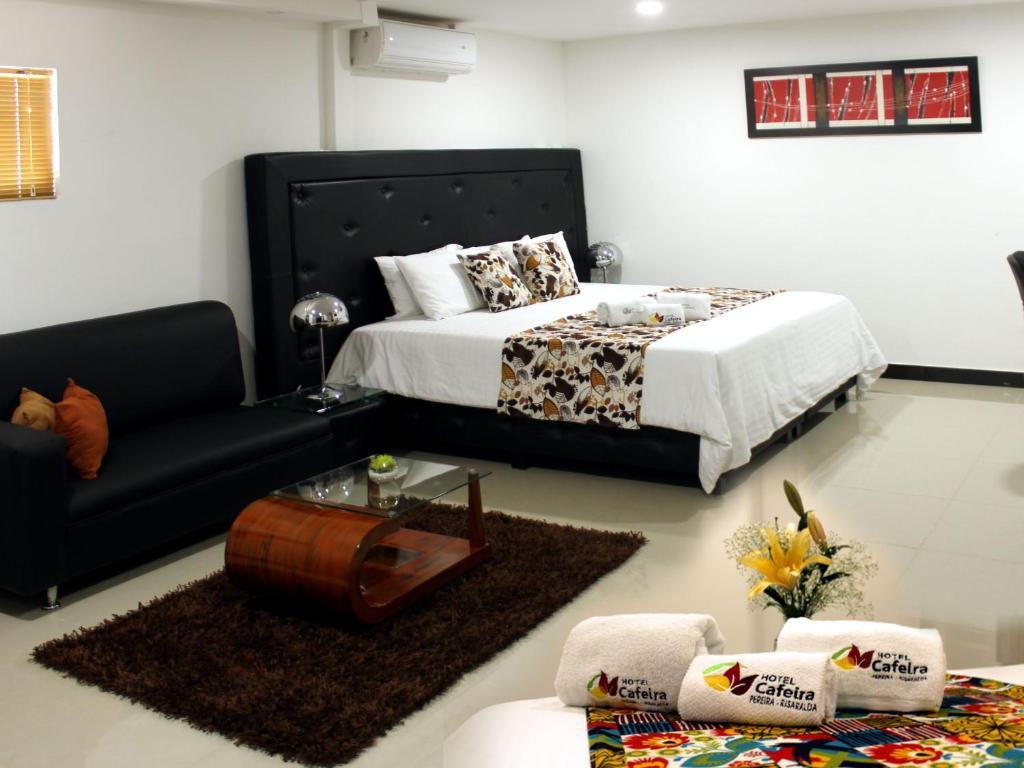 Кровать или кровати в номере Hotel Cafeira