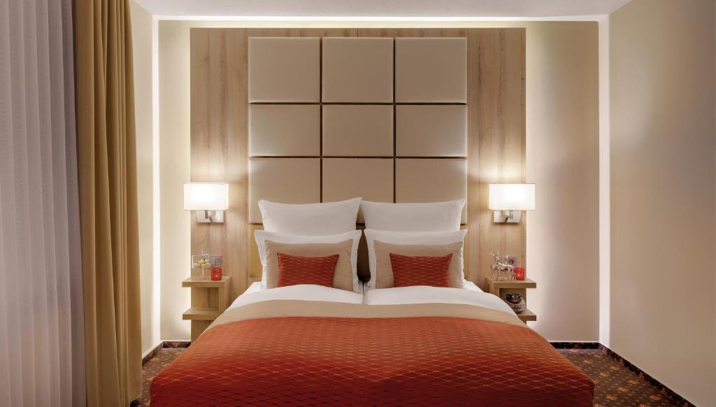 Ein Bett oder Betten in einem Zimmer der Unterkunft Hotel Wegner