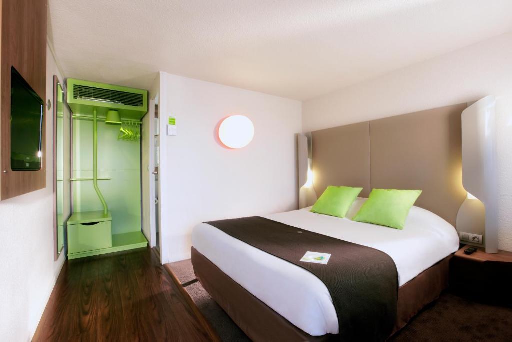 Un ou plusieurs lits dans un hébergement de l'établissement Campanile Hotel Mont de Marsan
