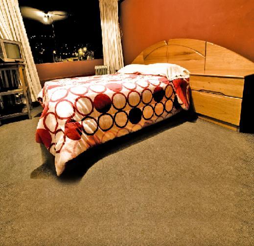 Cama o camas de una habitación en Casa De Mi Abuelo Hostal