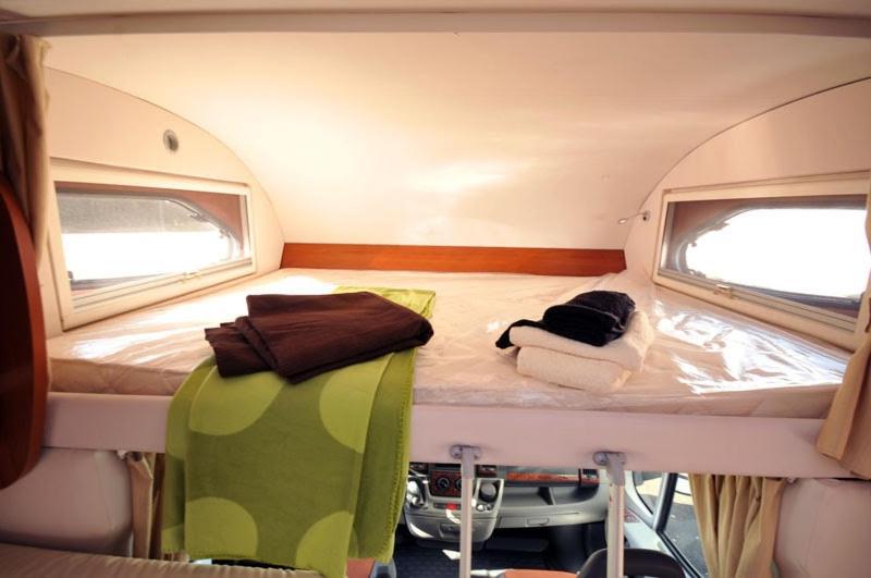 A bunk bed or bunk beds in a room at Playa de El Saler