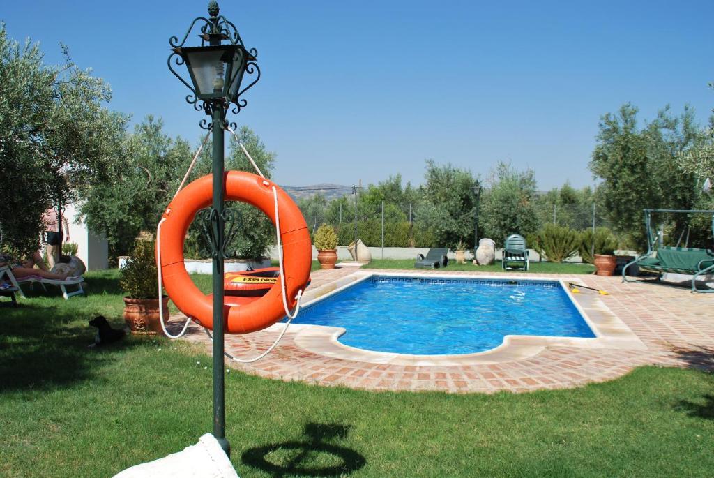 The swimming pool at or near Agroturismo Ecologico el Cortijillo