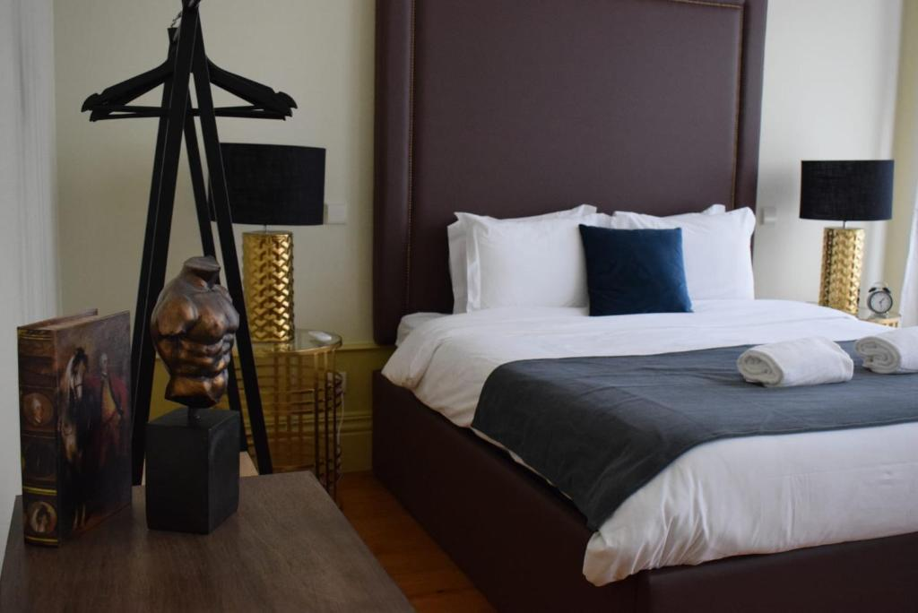 A bed or beds in a room at ML Boutique House Alegria