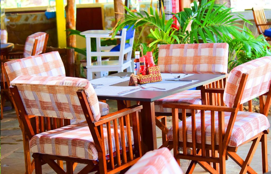 A restaurant or other place to eat at Reef Hotel Mombasa
