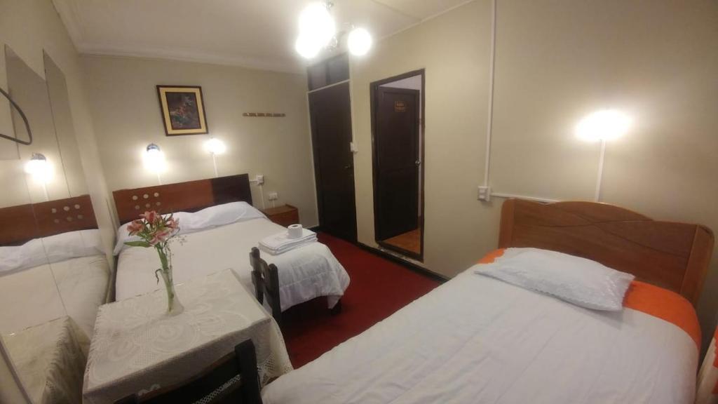 Cama o camas de una habitación en Wayna Inka Ollantay