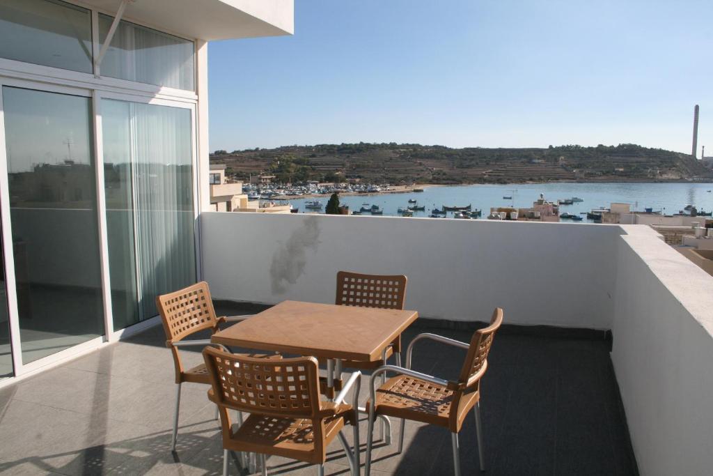 Balcon ou terrasse dans l'établissement Harbour Lodge