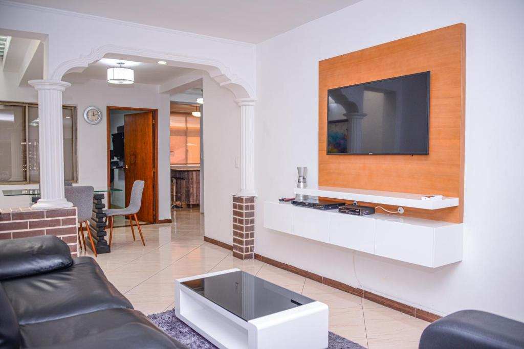 A television and/or entertainment center at Poblado Brownstone
