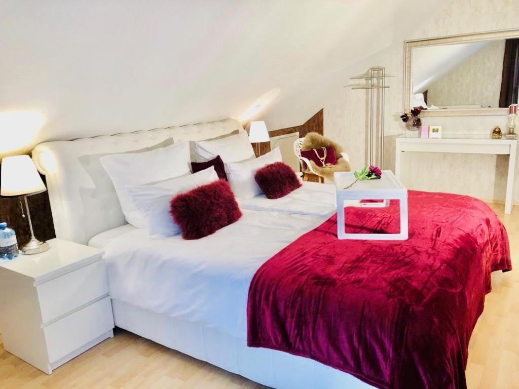 A bed or beds in a room at Baden Airpark Family Apartment