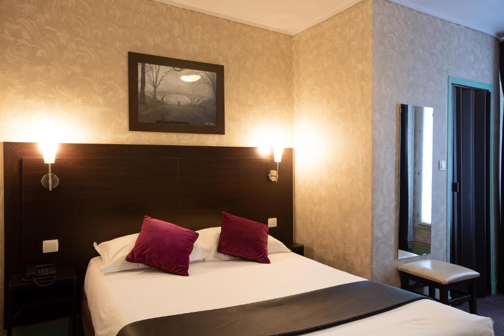 Un ou plusieurs lits dans un hébergement de l'établissement Hotel Prince Albert Opéra