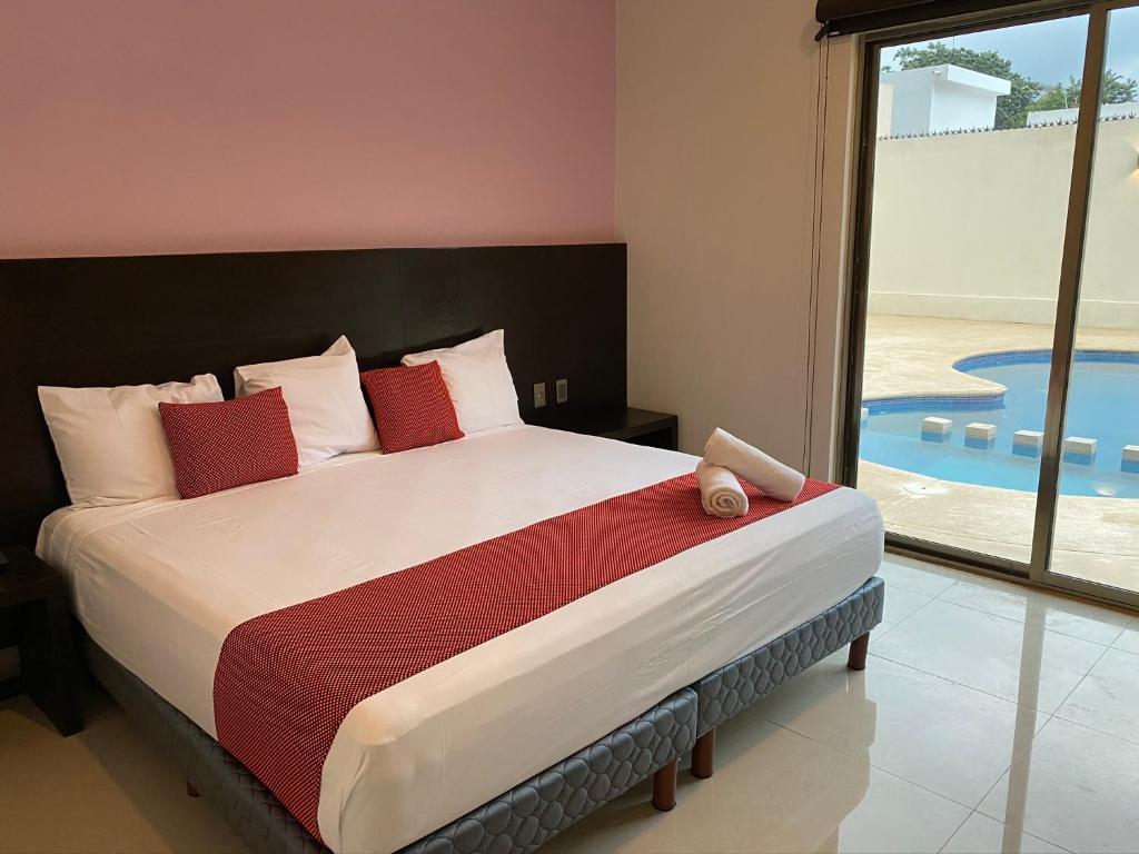 Cama o camas de una habitación en Hotel Ambra