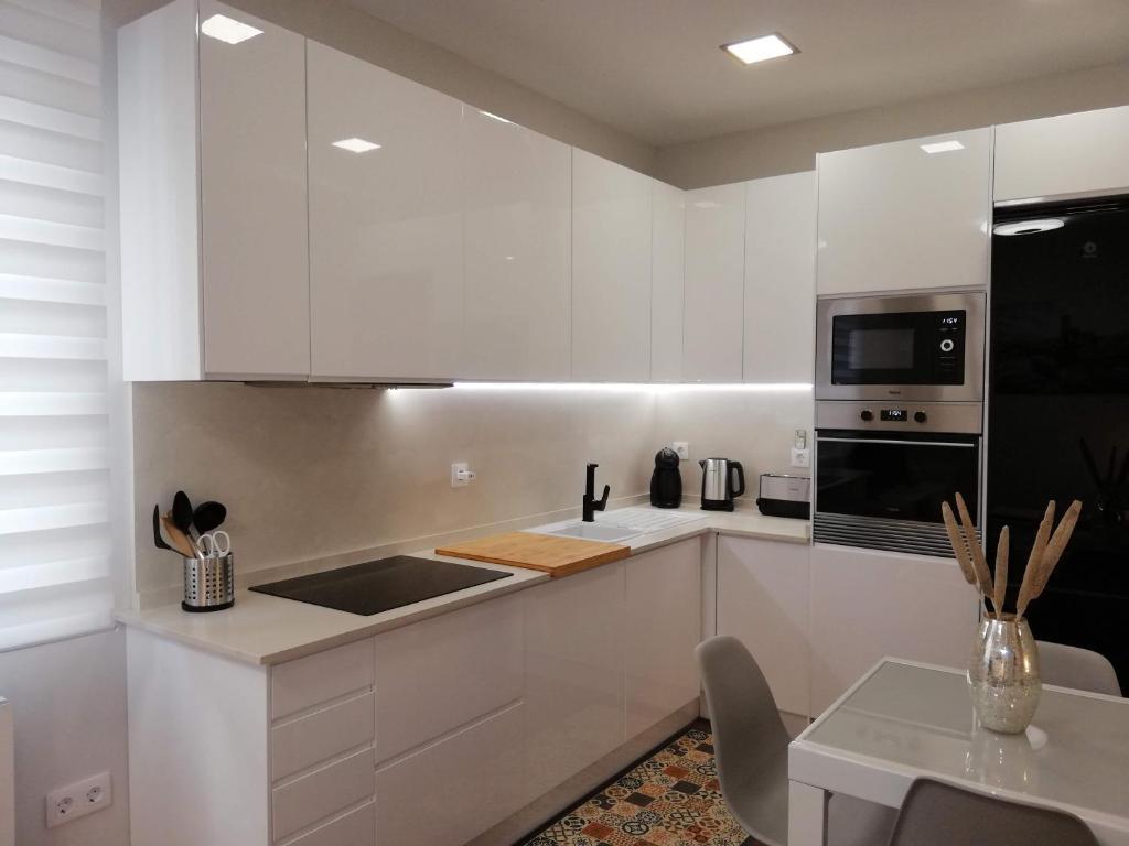 A kitchen or kitchenette at Kaixo