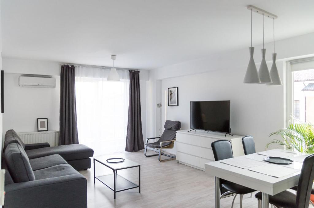 A television and/or entertainment center at Airport Residence - Apartment across from Otopeni Airport