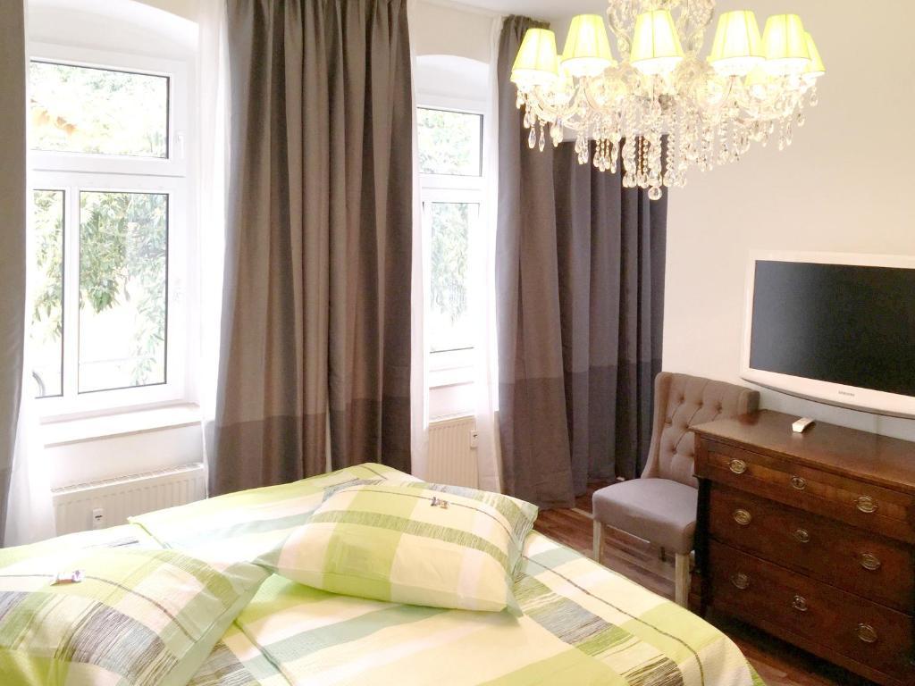 Ein Bett oder Betten in einem Zimmer der Unterkunft Apartment Webergasse