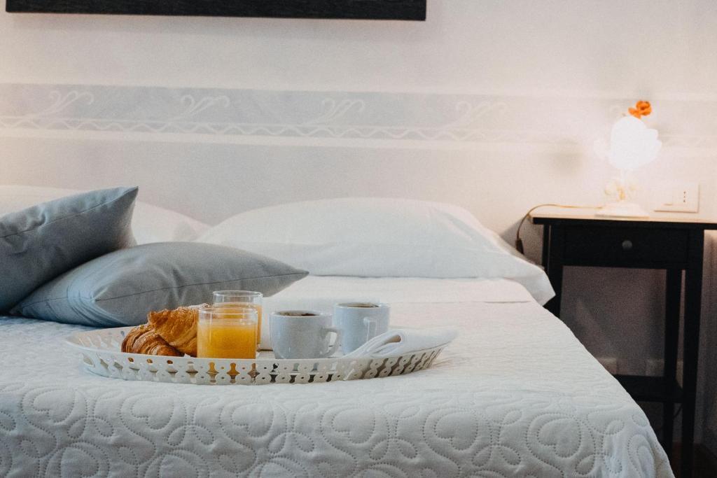 Ein Bett oder Betten in einem Zimmer der Unterkunft Hotel La Valle dell'Aquila