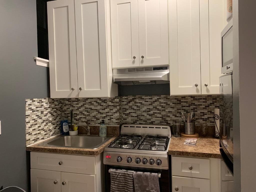 A kitchen or kitchenette at Your Home in Harlem