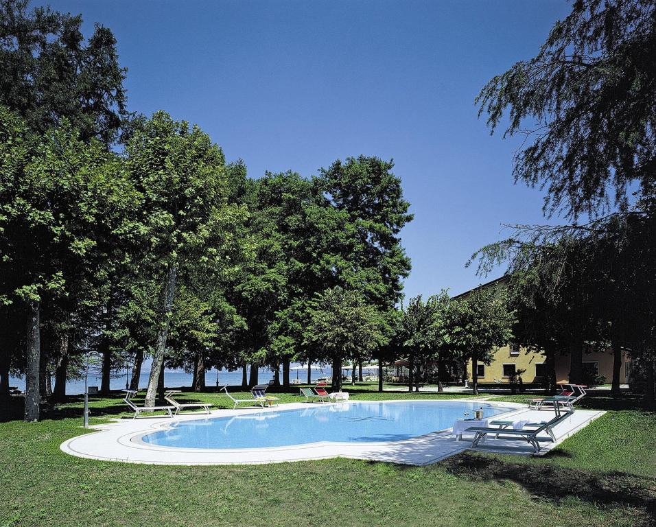 The swimming pool at or near Hotel Lugana Parco Al Lago