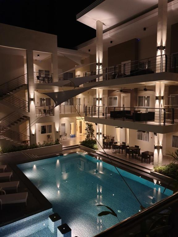 The swimming pool at or near Rovira Suites
