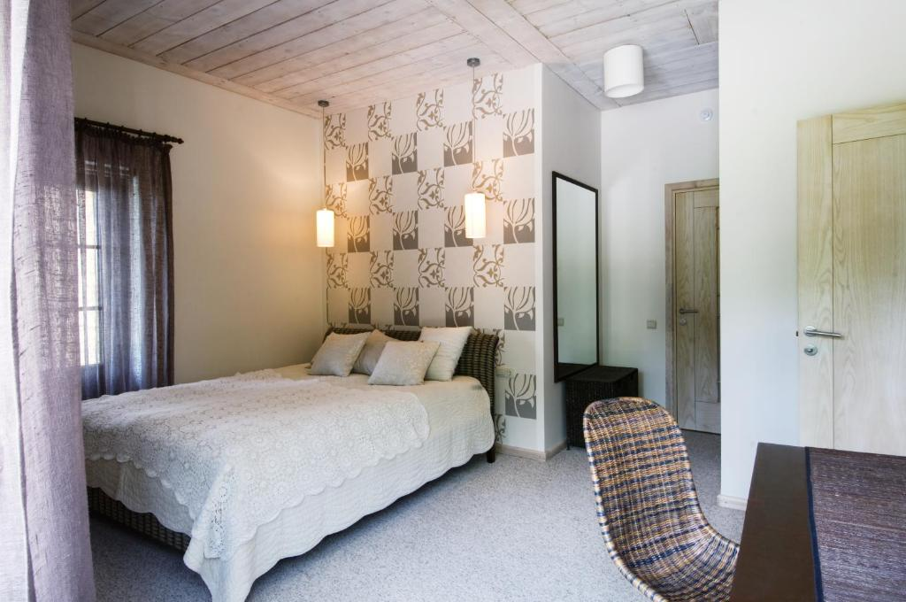 A bed or beds in a room at Reinis