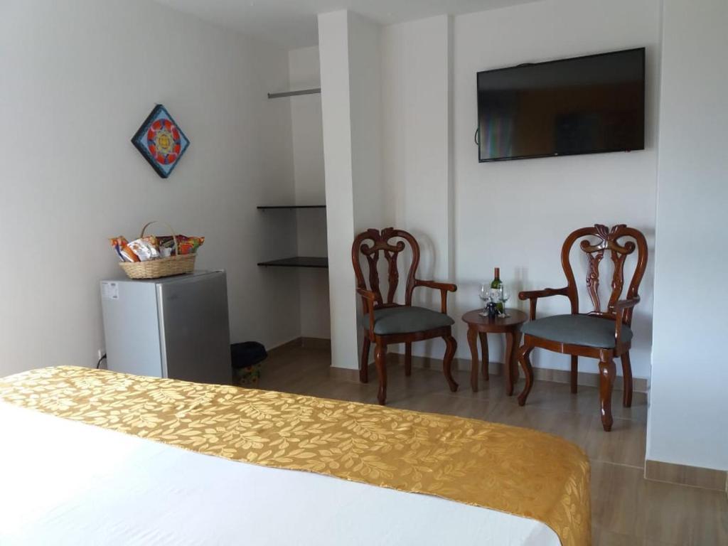 Mobile Tv Con Camino hotel anzea, anserma, colombia - booking