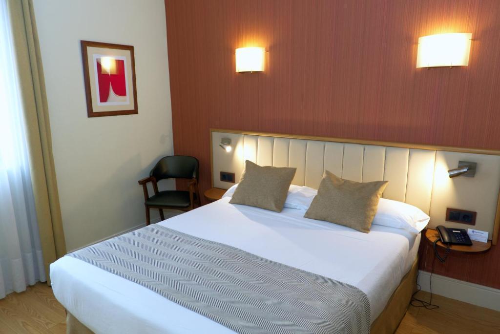 Cama o camas de una habitación en Hotel Los Condes